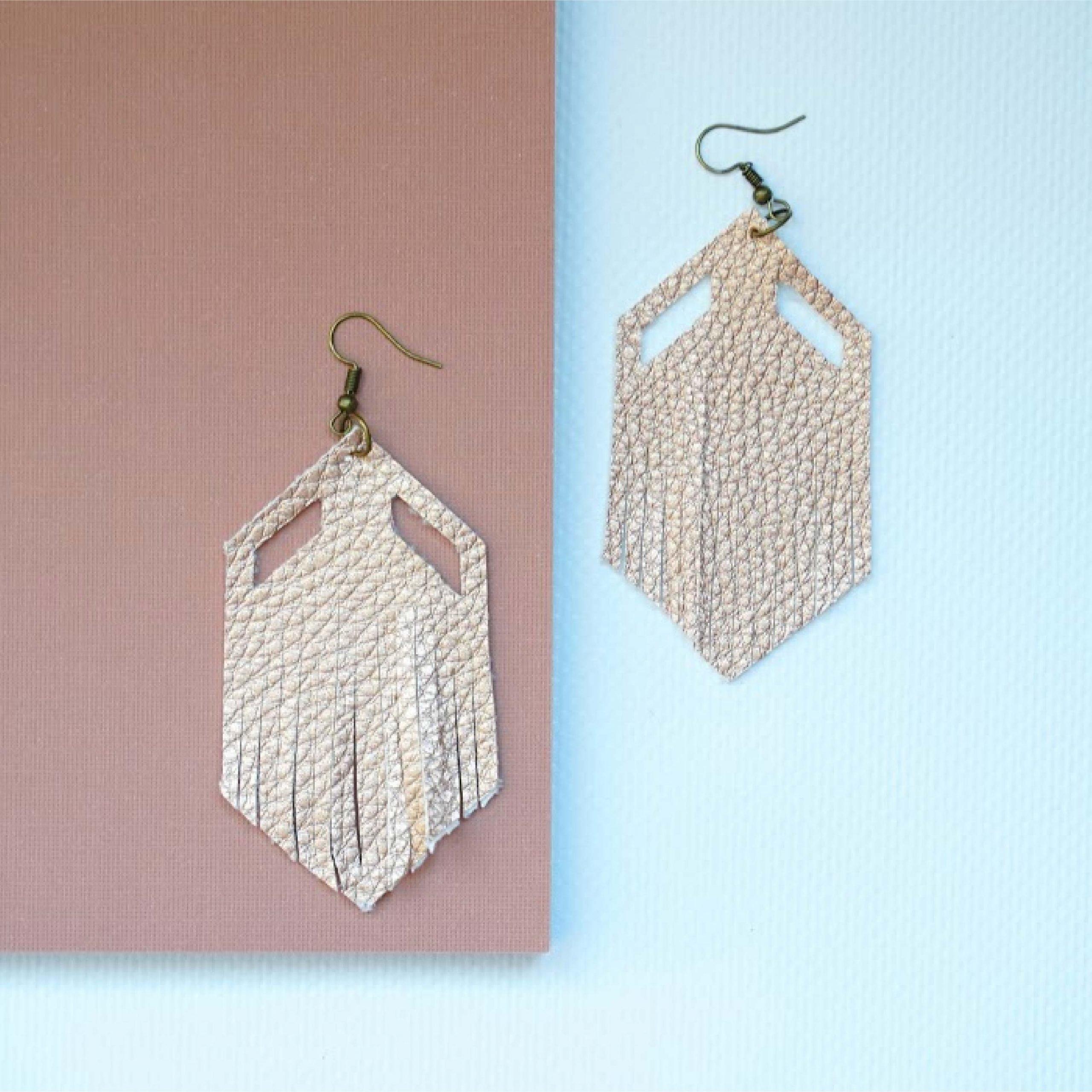 geo feather earrings